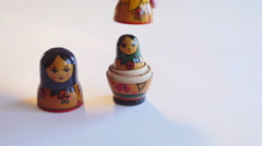 Man parses Matryoshka Doll on a white background in 4k Stock Footage
