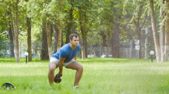 Sporty man or instructor doing gymnastic exercise outdoor Stock Footage