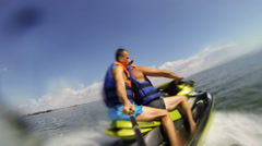 Henichesk, Ukraine - JULY 10, 2016: Riding Water Scooter. Two men riding jet ski Stock Footage