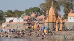 Pilgrims bathing in river on Ram Ghat,Ujjain,India Stock Footage