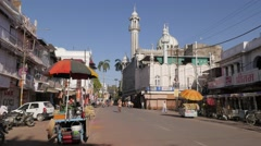 Street with snack stall and mosque,Ujjain,India Stock Footage