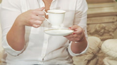 Pretty woman holds a cup of coffee and smiling. Slow motion Stock Footage
