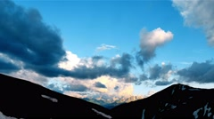 High Snowy Mountains with Clouds Sunset Timelapse. Kavkaz region Stock Footage