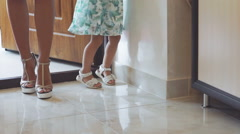 Pretty woman with little girl stand in door, go and smiling. Slowly Stock Footage