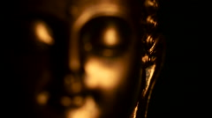 Spiritual golden face of meditating / content Buddha figure, against black bg #2 - stock footage