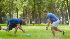 Two sporty man or instructors doing gymnastic exercise outdoor Stock Footage