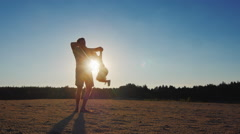 Happy childhood - a father playing with his son at sunset, much circling it Stock Footage