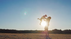 Strong father lobbed son in the sky. Playing with him at sunset Stock Footage