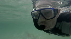 Snorkel diver swimming Stock Footage