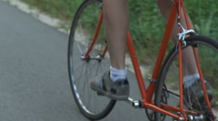 Close up hipster on bike in the city at sunset. Shot with sunflare and without Stock Footage