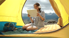 Tablet pc - camping woman taking picture photo selfie selfportrait at campsite Stock Footage