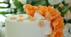 Wedding orange cake with flowers Stock Footage