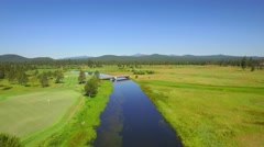 Aerial view of water by golf course and mountains in Oregon 7 Stock Footage