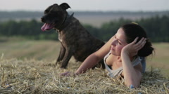 Portrait of a girl with a terrier.Young woman with a dog in the manger. Stock Footage
