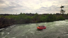 Aerial view of family whitewater rafting on river through Oregon forest 2 Stock Footage