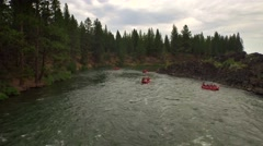 Aerial view of whitewater rafting by forest in Oregon Stock Footage