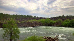 Aerial view of Oregon whitewater rapids next to forest 2 Stock Footage
