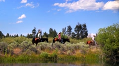 Group of people riding horses on trail under gorgeous sky Stock Footage