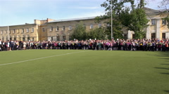 Parade of students of different classes on line in honor of the Day of Knowledge Stock Footage