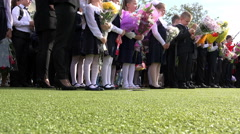 line of students dressed in school uniform meets September 1 Day of Knowledge - stock footage