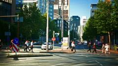 4K Busy traffic commuters Mainzer street crosswalk zebra cross Frankfurt am Main Stock Footage