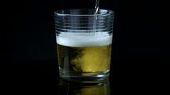 Beer Being Poured into Glass Cup. Stock Footage