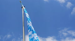 Bavarian flag in front of blue sky Stock Footage