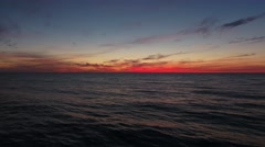 Aerial amazing shot of a beautiful ocean sunset at dusk time Stock Footage