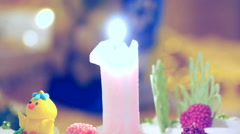 Birthday cake with burning candle Stock Footage