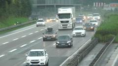 Rain on the highway Stock Footage