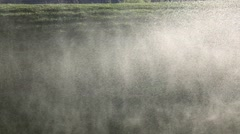 Automatic watering system on green grass. Slow motion - stock footage