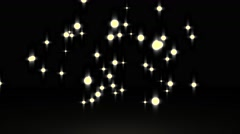 Gowing star particle in random direction with bounce on spotlight ground abst Stock Footage
