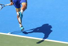 Tennis player serves the ball Stock Photos