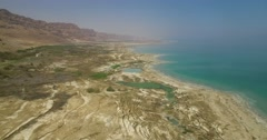 Sinkholes in the coast line of the  dead sea Stock Footage