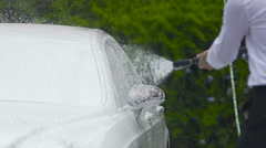 Successful businessman washing car before business trip, taking care of auto Stock Footage