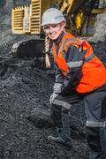 Worker with coal in the hands - stock photo