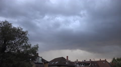 4k Fat grey clouds timelapse over backstreet city roofs Stock Footage