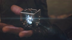 Plasma is in a fantastic cube in the hand of man is transforming. Stock Footage