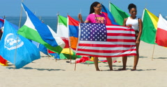 Patriotic black women hold an American flag in Venice Beach, Los Angeles 4K Stock Footage