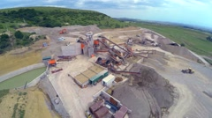 Aerial view of Processing of sand for paving (asphalting) on open pit - Quarr Stock Footage