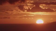 4K: Big Sun On The Horizon at Sunset Over Ocean Stock Footage