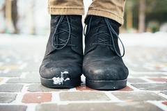 Women's boots in the snow - stock photo
