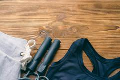 Women's sports clothing on a wooden background Stock Photos