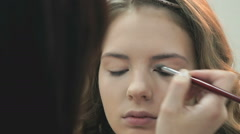 Makeup artist making make-up for the stylish bride Stock Footage