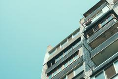 Details of a residential apartment building with balconies in a cheap area Stock Photos