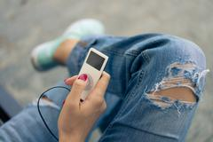 White portable music player in hand with red nail polish Kuvituskuvat