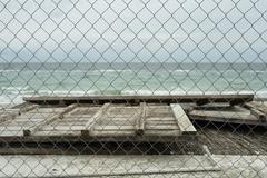 Sea view through the netting Stock Photos