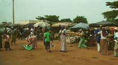 Traveling in Africa.  Video shots from a car to a market in Mali. Stock Footage
