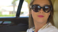 Rich woman travelling by car on back seat of expensive comfortable limousine Stock Footage