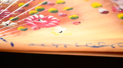Decorated hand fan with flowers and made in wood gyrating Stock Footage